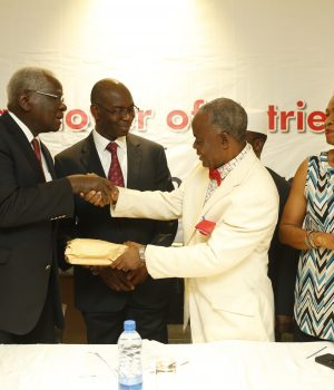 Professor Emeritus Ayo Banjo, Chairman Advisory Board of The Nigeria Prize for Literature, hands-over 89 entries to the Chairman, Panel of Judges, Professor Matthew Umukoro for 2018 edition of the prize as Godson Dienye, Acting Manager, Community Relations at Nigeria LNG and other judges, Dr. (Mrs.) Ngozi Udengwu and Professor Mohammed Inuwa Umar-Buratai, look on