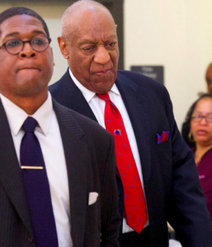 Cosby led out of the court by his counsel