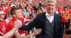Wenger gave his red club tie to one young fan after his post-match presentation