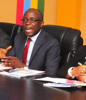 Lagos Finance commissioner, Akinyemi Ashade, middle stresses a point
