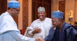 President Buhari in a handshake with Gov. Badaru of Jigawa. Middle is Gov. of Bauchi State