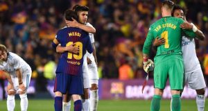 Barca, Real Madrid players embrace after a 'turbulent' El-Clasico