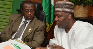 Dr. Maikanti Baru (left), with NNPC Chief Financial Officer (CFO), Mr. Isiaka AbdulRazaq, reviewing a document during the Steering Committee Meeting