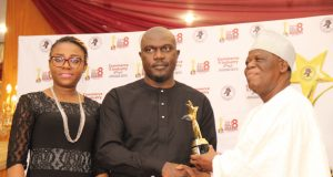 "Temitayo Ade-Peters, CSR Lead, Olumide Orojimi, Head, Corporate Communications, NSE receiving the 2018 award for ""CSR in Education"" from, Asiwaju S. K. Onafowokan,"