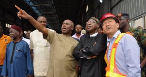 L-R; Chairman, Board of NRC, Usman Abubakar; Rotimi Amaechi; Lai Mohammed, and the Deputy Production Manager of CCECC, Xih Lijun, during the inspection of ongoing construction of the Lagos-Ibadan standard gauge rail line in Papalanto