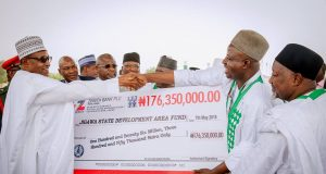 President Buhari presents SIP cheque to ALGON Chairman
