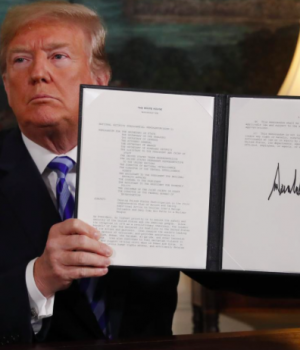 Trump displays a presidential memorandum after announcing his intent to withdraw from the JCPOA Iran nuclear agreement in the Diplomatic Room at the White House in Washington,
