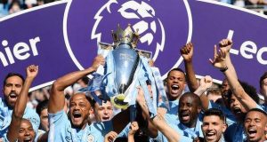Manchester City captain Vincent Kompany lifts the Premier League trophy