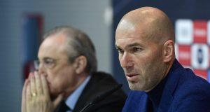 Real Madrid's French coach Zinedine Zidane (R) sits beside president Florentino Perez,