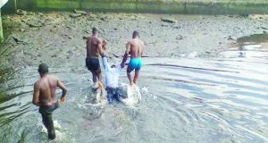 Drowned corps member being taken out of the river