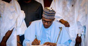 President Buhari signs the 2018 Budget