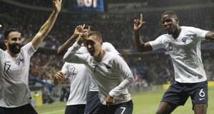Antonine and France teammates celebrate thrashing of Italy
