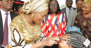 Convener, Lagos Women Forum, Mrs. Bolanle Ambode (left), presenting free eye glasses to one of the beneficiaries, Mrs. Faromiki Oluwabukola, during the Lagos Women Forum with the theme Women...Your Health...Your Social Environment