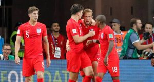 England's Harry Kane celebrates with Harry Maguire and Ashley Young after scoring their second goal