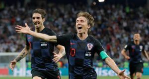 Croatia's Luka Modric, right, celebrates with teammates after scoring his side's second goal during the group D match between Argentina and Croatia at the 2018 soccer World Cup