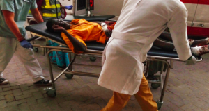 Emergency personnel receive an injured man at the hospital in Maiduguri