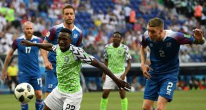Kenneth Omeruo of Nigeria is challenged by Birkir Saevarsson of Iceland
