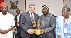 Ambode (2nd right), presents a souvenir to Zurab Pololikashvili, SEC. GEN, UNWTO(2nd left) while Lai Mohammed (right) and Commissioner for Tourism, Arts & Culture, Steve Ayorinde watch