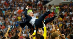 Excited French national team carry Coach Didier Deschamps
