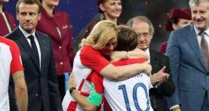 Croatian President Kolinda Grabar hugs Lucas Modric