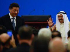 Kuwaiti ruling Emir Sheikh Sabah Al-Ahmad Al-Jaber Al-Sabah, right waves after giving a speech as China's President Xi Jinping