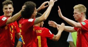 Belgian players celebrate victory over Brazil