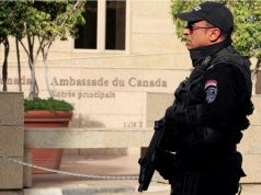 armed-police-officer-is-deployed-in-front-of-the-canadian-embassy-i