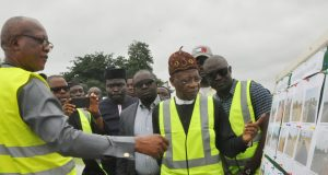 Federal Controller of Works in Kwara State, Wasiu (left), and Lai Mohammed, during visit to the construction of Ilorin-Jebba-Mokwa-Birnin Gwari-Kaduna road