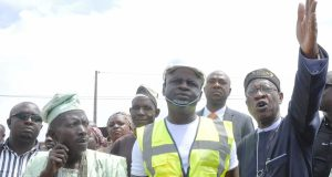 Lai Mohammed, with Asanlu of Oro, Chief Simon Olayemi, flag off the hometown road rehabilitation projects in Oro, Kwara