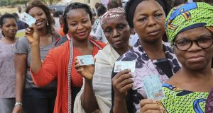 Nigerians waiting to cast their votes using the card readers