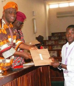 One of the students receiving his travel document