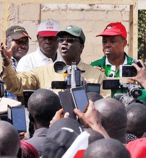 National President of the NLC, Comrade Ayuba Wabara (M) speaking during a protest over the sack of some civil servants