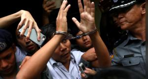 Reuters journalist Kyaw Soe Oo departs Insein court after his verdict