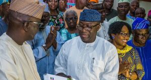 Dr. Fayemi receiving the Transition Committee reports from its chairman, Senator Bunmi Adetunmbi