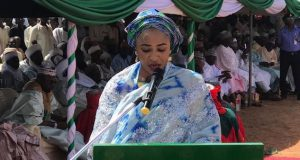 Hansatu Zannah delivering Mrs. Buhari's address.