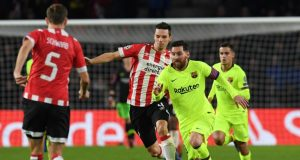 Barcelona's Lionel Messi in action with PSV Eindhoven's Nick Viergever