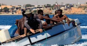 Migrants rescued by cargo ship refuse to disembark at Libyan port