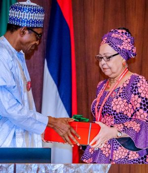 President Buhari receives the report of the National Minimum Wage from committee chairman, Amal Pepple