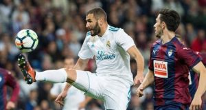 Real Madrid's Karim Benzema battles Eibar players