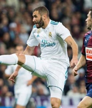 Real Madrid's Karim Benzema battles Eibar players