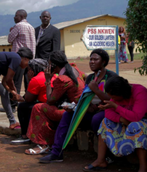 Parents await for news of their children at a school where 79 pupils were kidnapped in Bamenda, Cameroon November 6,