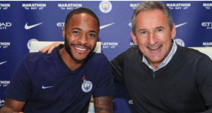 Sterling alongside Manchester City director of football Txiki Begiristain after signing his new deal