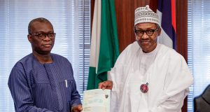 Iyi Uwadiae,, WAEC registrar presents the certificate to President Buhari