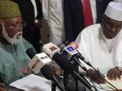 Abdulsalami Abubakar with Atiku signing the Peace Accord