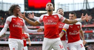 Arsenal players celebrate victory over Spurs