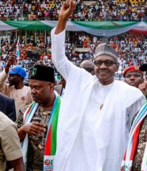 Adams Oshiomhole, President Buhari and Sen. Akpabio at the President's flag-off rally in Akwa-Ibom
