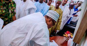 Buhari signs condolence register