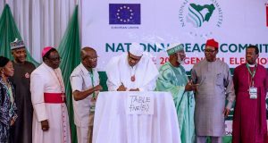 Buhari signs the Peace Accord