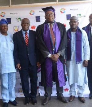 Omorodion in academic gown, flanked FUTA top management