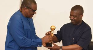 NDDC boss, Nsima Ekere being presented the award by SEPAN leader, Dr. Magnus Onuoaha,